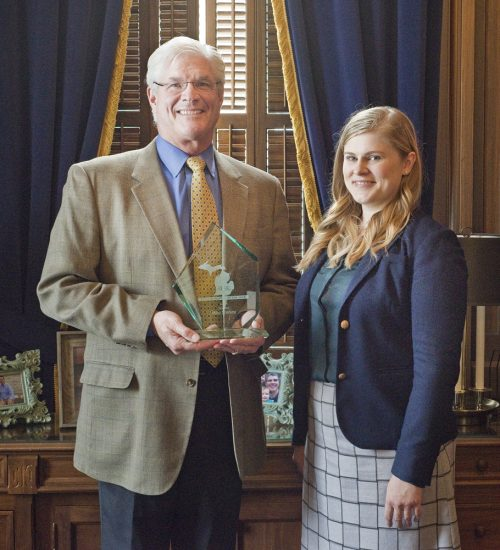 Amy Drumm presents Senate Majority Leader Mike Shirkey with the 2018 Legislator of the Year award. (Photo by Patrick D. Kerwin)